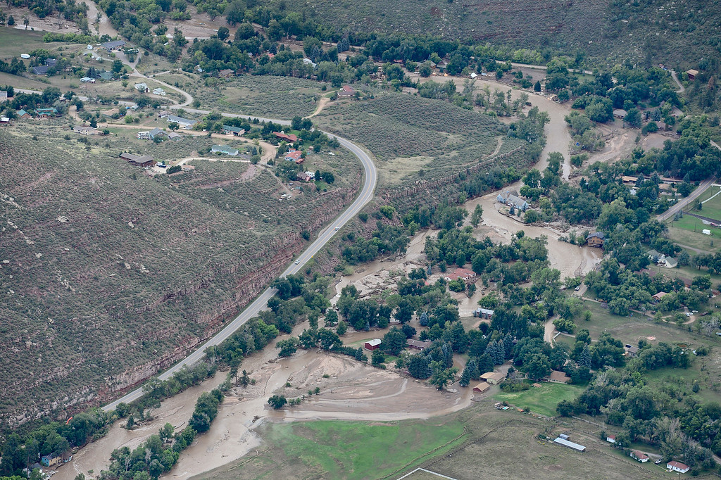 . A flooded St. Vrain River is seen, Saturday, Sept. 14, 2013, near Lyons. (Matthew Jonas/Times-Call)