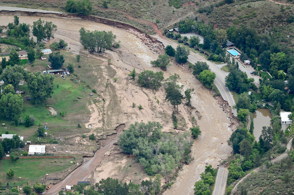 . North St. Vrain Drive is seen damaged by flooding from the North St. Vrain Creek, Saturday, Sept. 14, 2013, in Lyons. (Matthew Jonas/Times-Call)