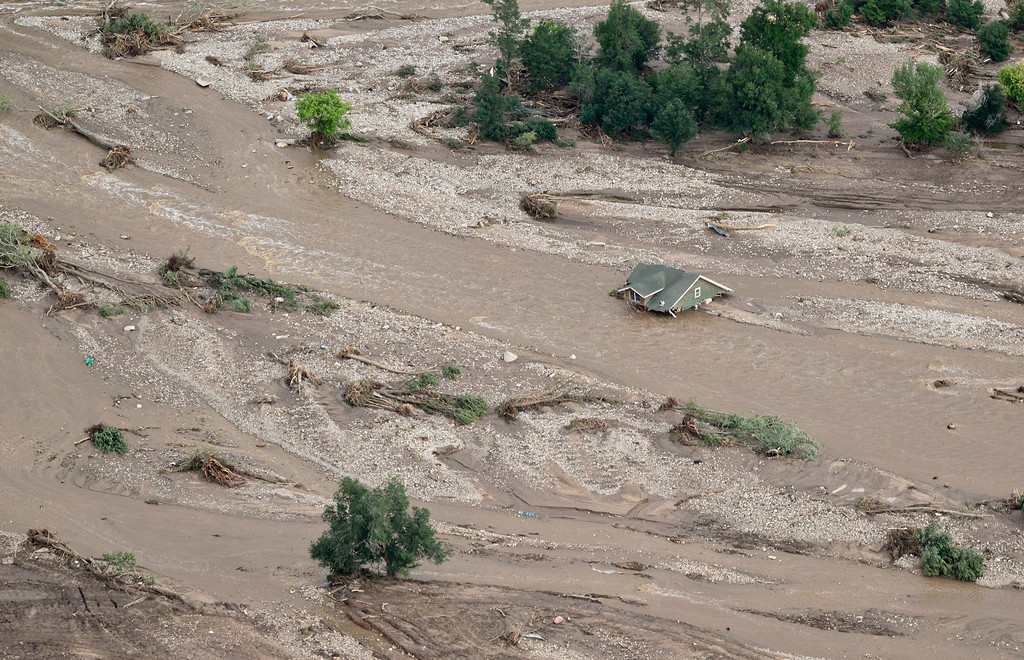 . The roof of a house is seen along with debris caused by flood damage, Saturday, Sept. 14, 2013, near Lyons. (Matthew Jonas/Times-Call)