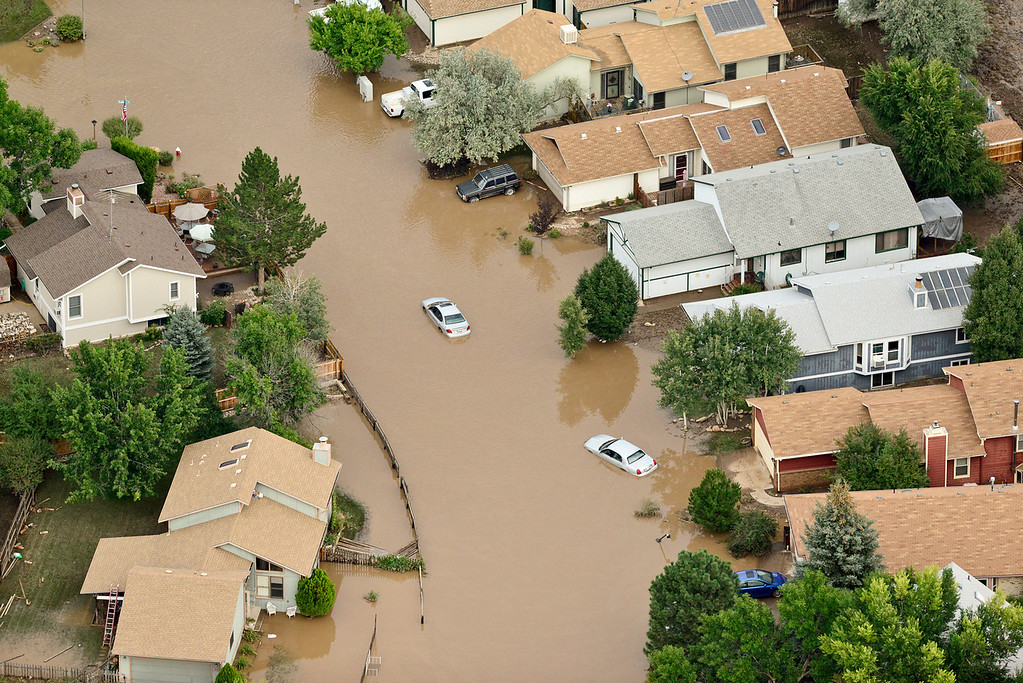 . Flood waters cover much of the roadway near Dudley Lane and Hayden Court, Saturday, Sept. 14, 2013, in Longmont. (Matthew Jonas/Times-Call)