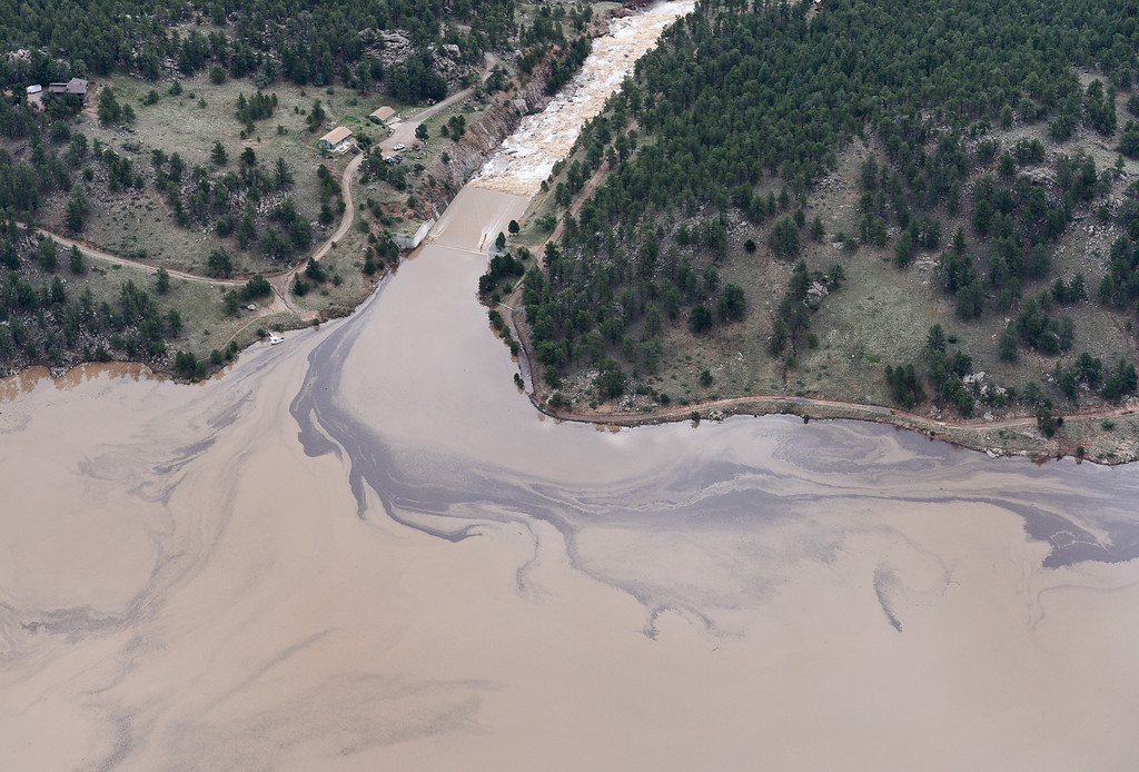 . Silt and debris are seen in the water near the emergency spillway at Button Rock, Saturday, Sept. 14, 2013, near Lyons. (Matthew Jonas/Times-Call)