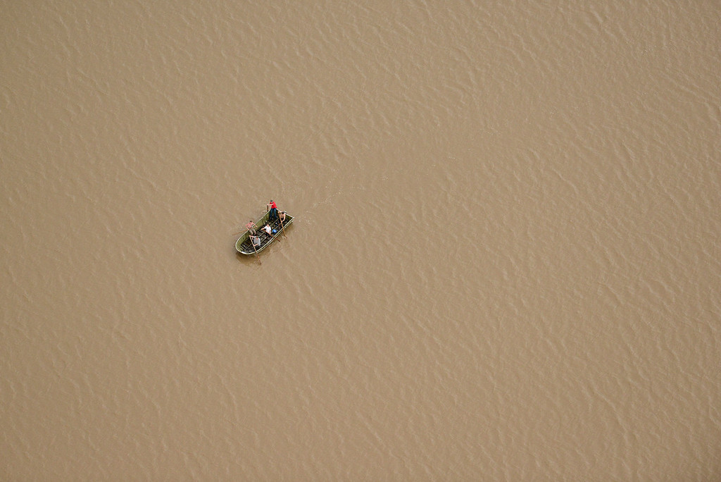. People are seen paddling across a flood water, Saturday, Sept. 14, 2013, near Longmont. (Matthew Jonas/Times-Call)