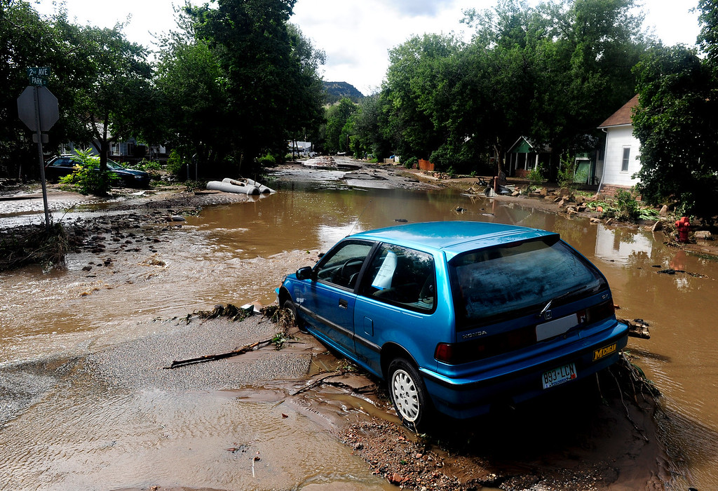 . Flood damage in Lyons Friday, Sept. 13, 2013. For more photos visit www.TimesCall.com. (Greg Lindstrom/Times-Call)