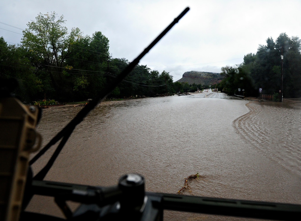. Water covers Colo. Highway 66 into Lyons Friday, Sept. 13, 2013. For more photos visit www.TimesCall.com. (Greg Lindstrom/Times-Call)
