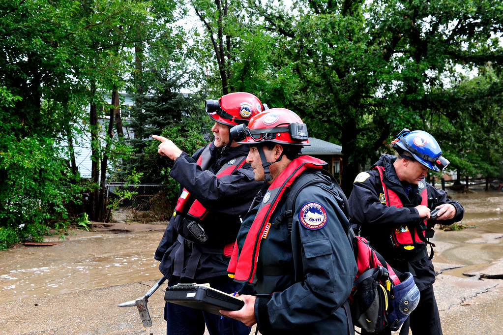 . Crews from Colo. Task Force Urban Search and Rescue searched flooded areas for stranded or missing persons in Lyons Friday, Sept. 13, 2013. For more photos visit www.TimesCall.com. (Greg Lindstrom/Times-Call)