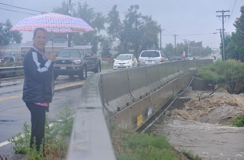 . A pile of debris rests against the bridge over St. Vrain River, Thursday, Sept. 12, 2013, in Longmont. (Matthew Jonas/Times-Call)