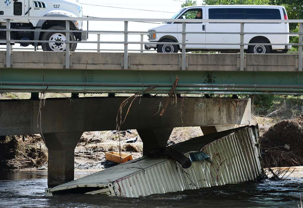 . A shipping container, containing a large-scale prototype construction system, which was on the property of Zometool, 1040 Boston Ave., before the flood lies in the St. Vrain River underneath the South Main Street bridge Thursday, Sept. 19, 2013. (Lewis Geyer/Times-Call)
