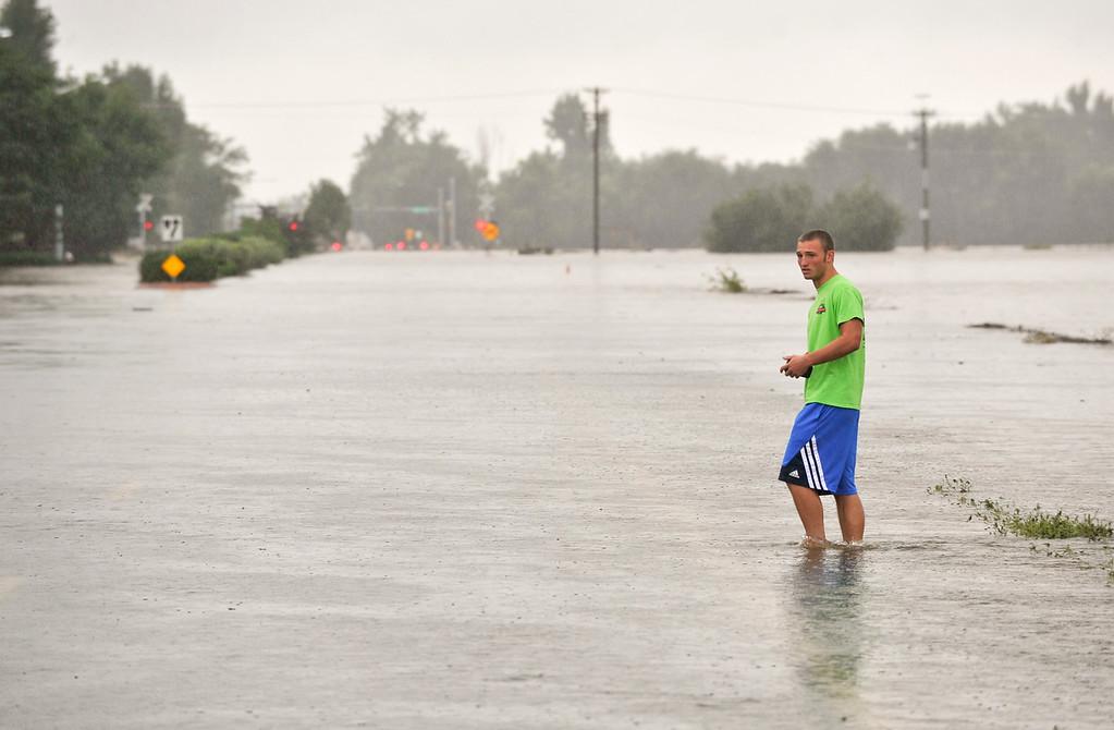 . Logan Goodner, 16, of Longmont, crosses Airport Road near Mountain View Avenue, Thursday, Sept. 12, 2013, in Longmont. (Matthew Jonas/Times-Call)