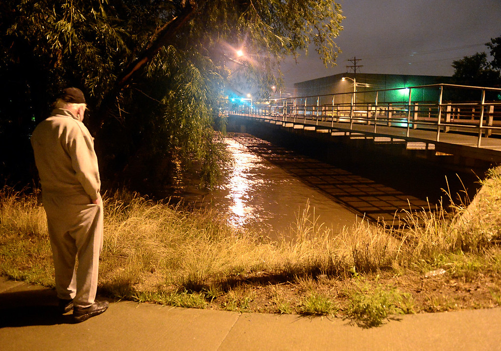 . Ronald Nelvin, 66, looks at river levels near the South Pratt Parkway underpass Thursday morning, Sept. 12, 2013. For more photos visit www.TimesCall.com. (Greg Lindstrom/Times-Call)