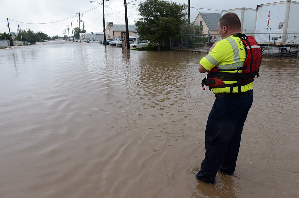 . Longmont fire lieutenant Mike Becker manages a rescue operation on Boston Avenue in front of Left Hand Brewery Thursday Sept. 12, 2013. (Lewis Geyer/Times-Call)