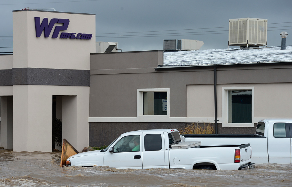 . A man is trapped in his pickup outside W.P. Manufacturing at Price Road and Boston Avenue Thursday Sept. 12, 2013. (Lewis Geyer/Times-Call)