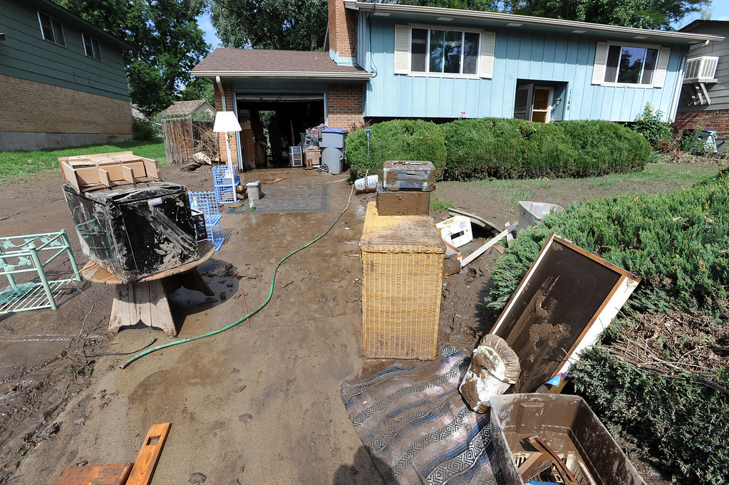 . Longmont Flood Damage Day 3 229.JPG The flood damaged belongings of this family are taken outside of this mud filled home on Lefthand Drive in Longmont, Colorado on September 14, 2013. Cliff Grassmick / September 14, 2013