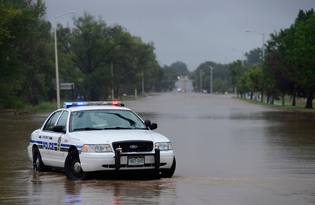 . A Longmont police car sits on a flooded Hover Street at Boston Avenue Thursday Sept. 12, 2013. (Lewis Geyer/Times-Call)