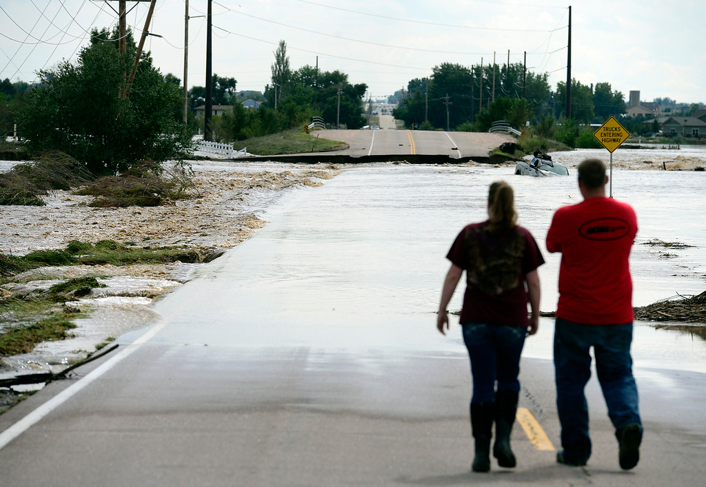 . Flood waters pour over a washed out Weld County Road 13, a quarter mile south of WCR 28, north of Firestone, Friday afternoon Sept. 13, 2013. (Lewis Geyer/Times-Call)