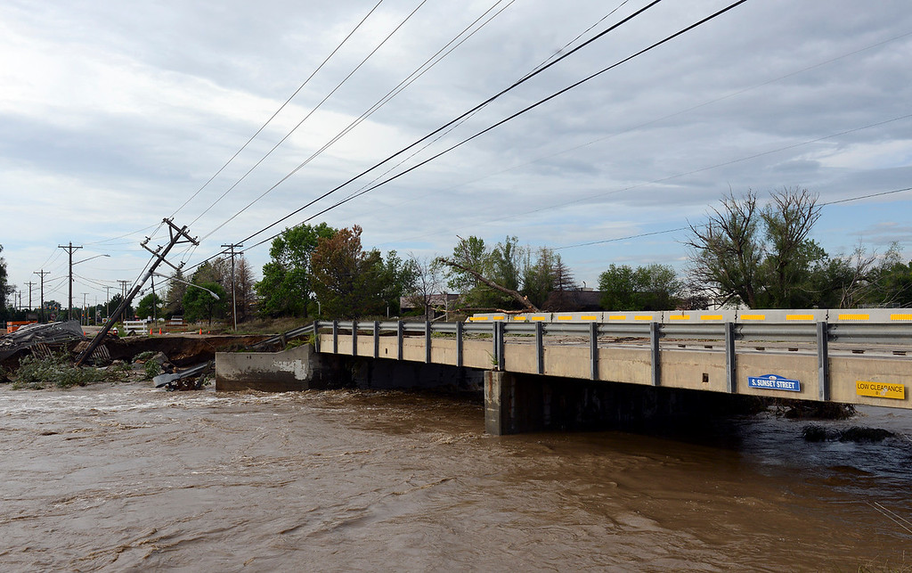 . Looking south from Izaak Walton Park, the washed out bridge on South Sunset Street Saturday morning, Sept. 14, 2013. (Lewis Geyer/Times-Call)