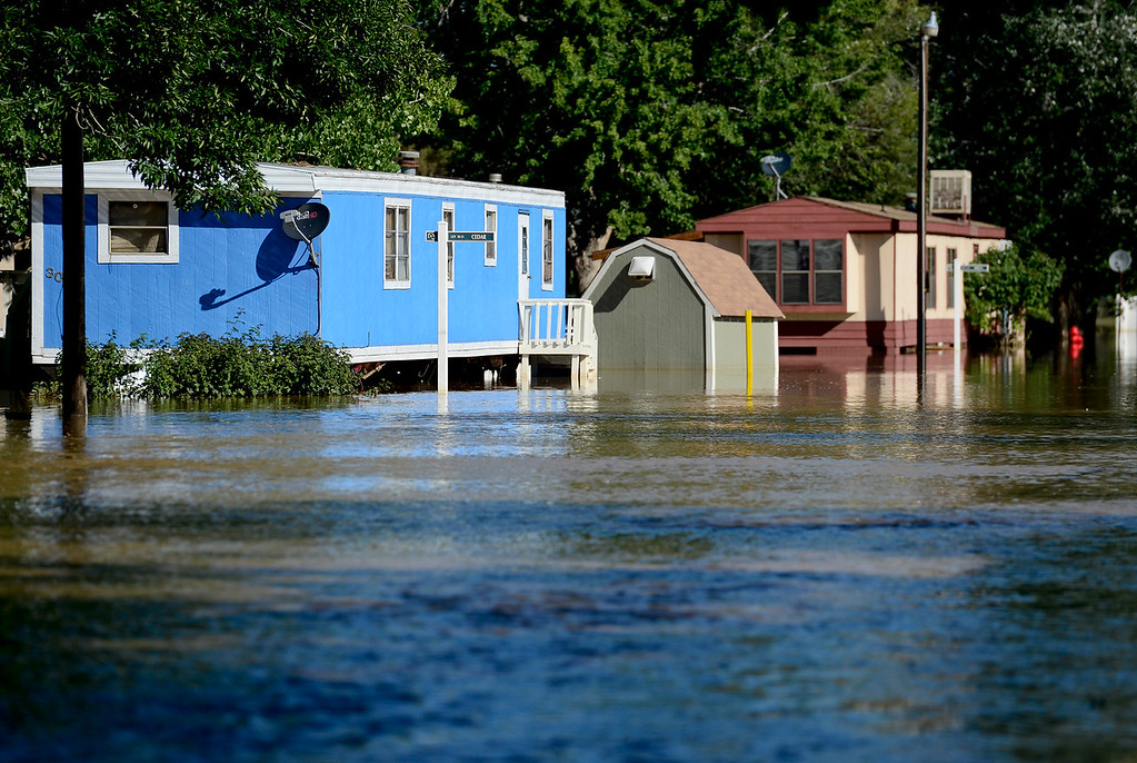 . Mobile homes in River Valley Village on Cedar Avenue and Birch Avenue are seen surrounded by flood water, Tuesday, Sept. 17, 2013, in Del Camino. (Matthew Jonas/Times-Call)