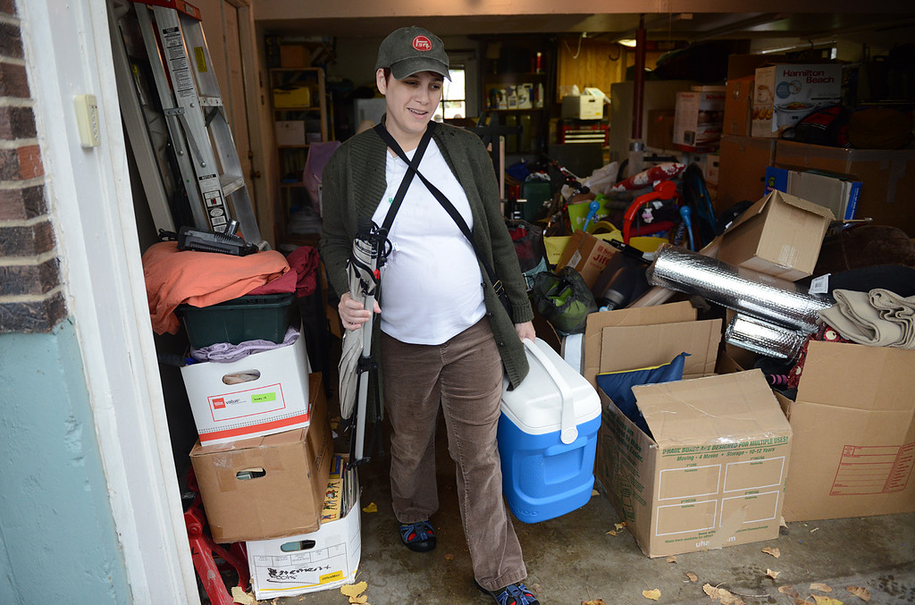 . Dawn Stanley, who is due in November, evacuates her home at S. Bowen Street and Missouri Avenue at 9:15 a.m. Thursday Sept. 12, 2013. (Lewis Geyer/Times-Call)