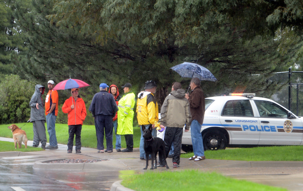 . Residents gather on Horizon Blvd near McIntosh Lake to get information  in Longmont, Colorado on September 15, 2013. Cliff Grassmick / September 14, 2013