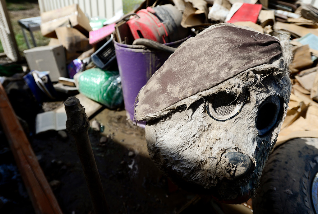 . A furry mask is seen in a pile of flood damaged belongings next to a storage unit, Monday, Sept. 23, 2013, at Storage West Self Storage in Longmont. (Matthew Jonas/Times-Call)