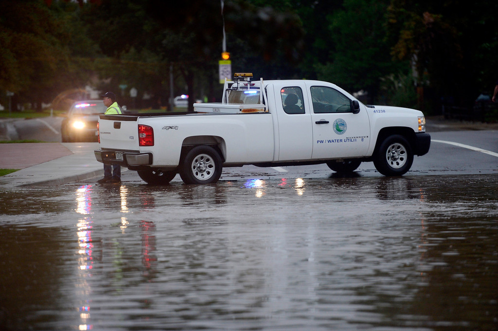 . Flooded Missouri Avenue at S. Pratt Pkwy. Thursday morning 8:15 a.m., Sept. 12, 2013. (Lewis Geyer/Times-Call)