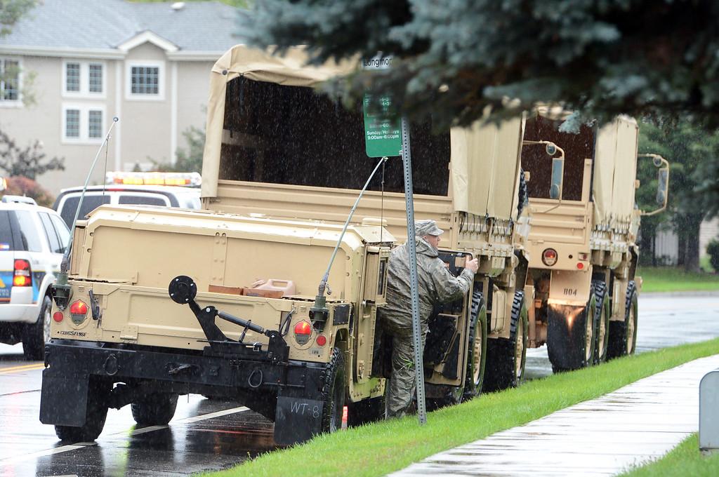 . National guard troops wait  near McIntosh Lake in Longmont, Colorado on September 15, 2013. Cliff Grassmick / September 14, 2013