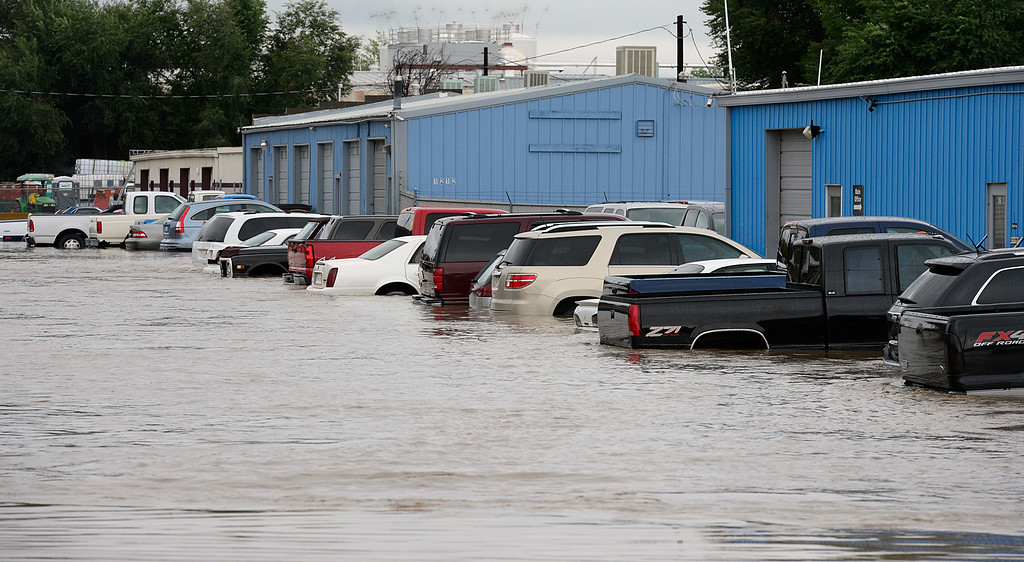 . A flooded street near Price Road and Boston Avenue Thursday Sept. 12, 2013. (Lewis Geyer/Times-Call)