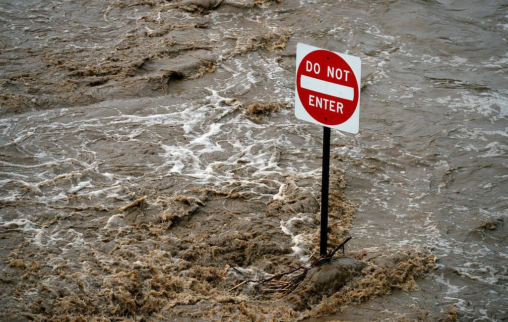 . Flood waters surround a road sign near South Pratt Parkway 7 a.m. Friday, Sept. 13, 2013. (Lewis Geyer/Times-Call)