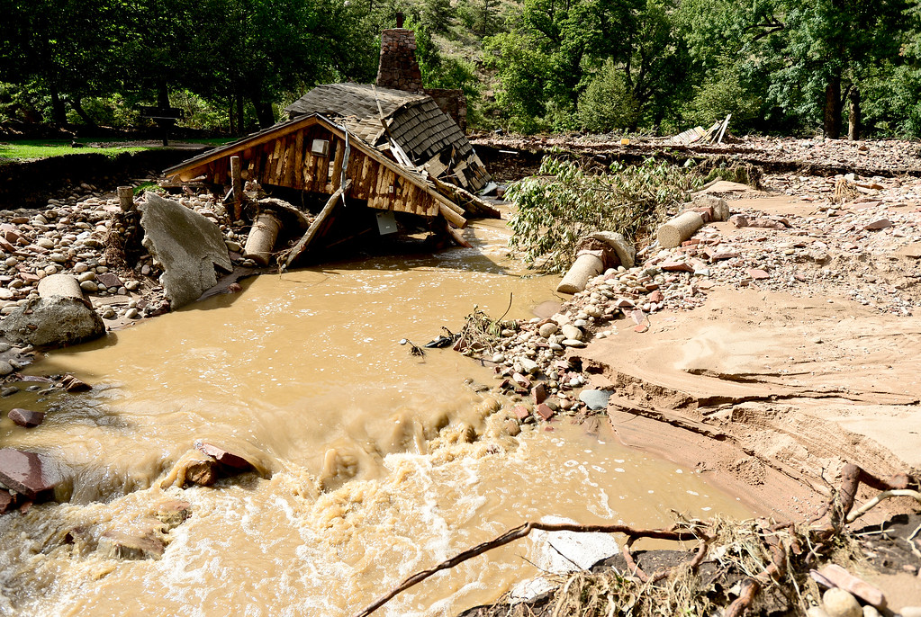. Part of a historic pavilion is seen destroyed by flood water in Meadow Park, Monday, Sept. 16, 2013, in Lyons. (Matthew Jonas/Times-Call)
