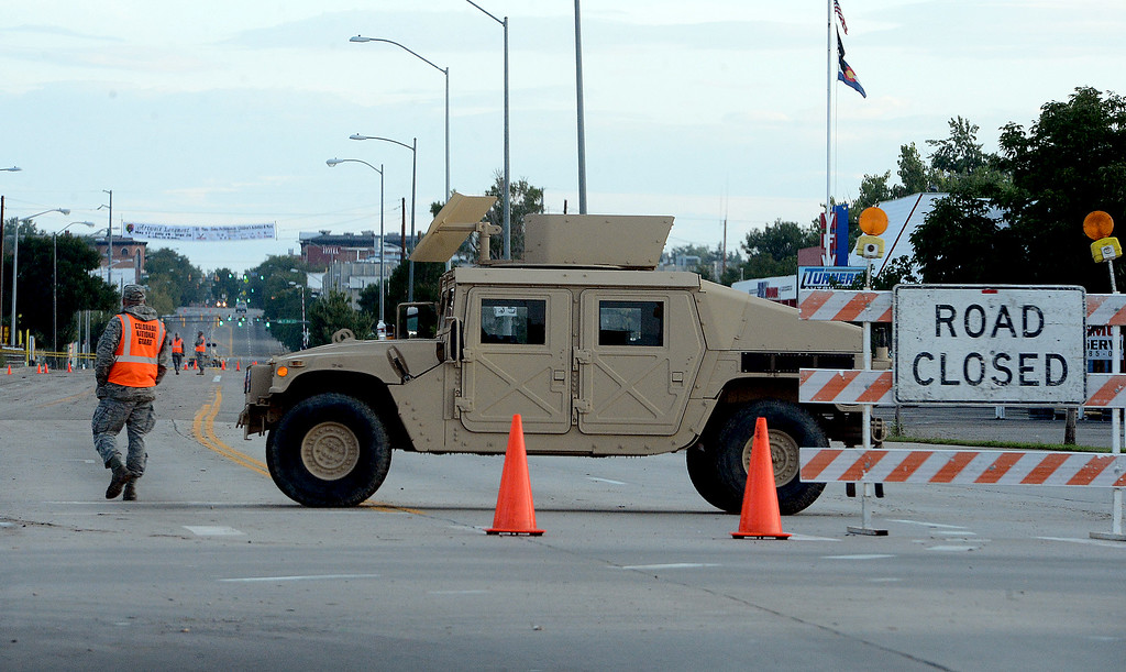 . National Guard troops stationed at Main Street and Ken Pratt Blvd at sunrise of Saturday morning.  A total of 56 Colorado National Guard have been stationed with 28 Humvees at traffic control points throughout Longmont. Cliff Grassmick / September 14, 2013