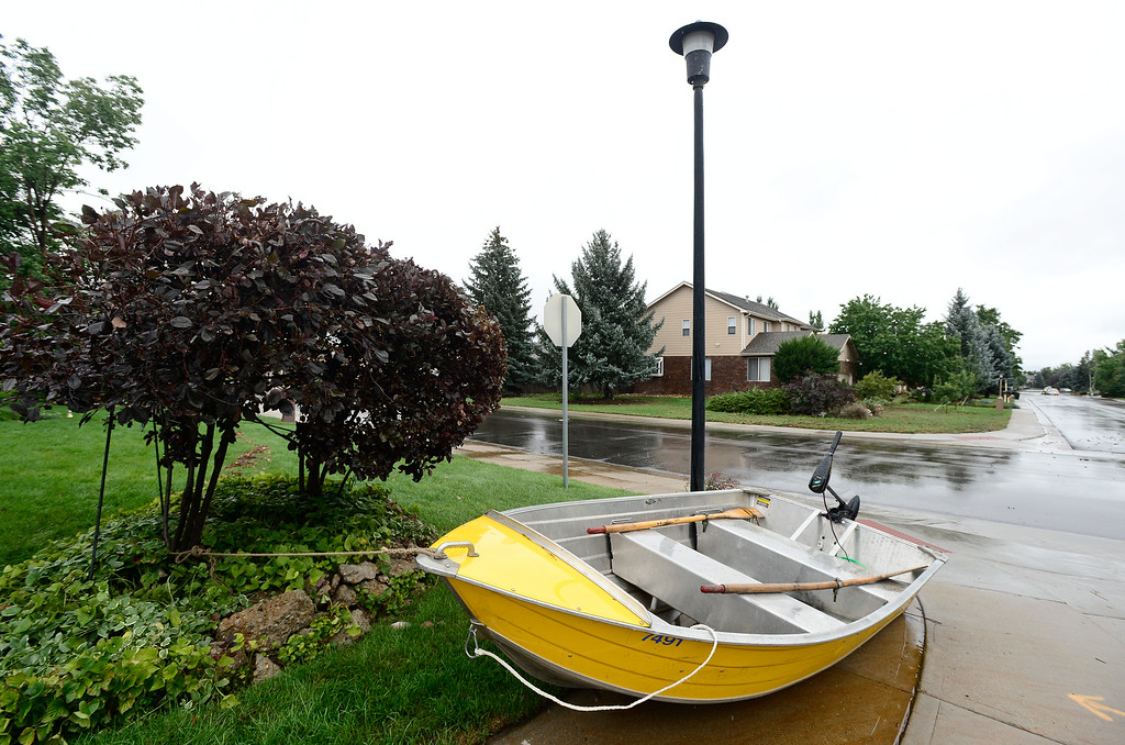 . A boat is seen tied to a tree off of Columbia Drive, Sunday, Sept. 15, 2013, in Longmont. (Matthew Jonas/Times-Call)