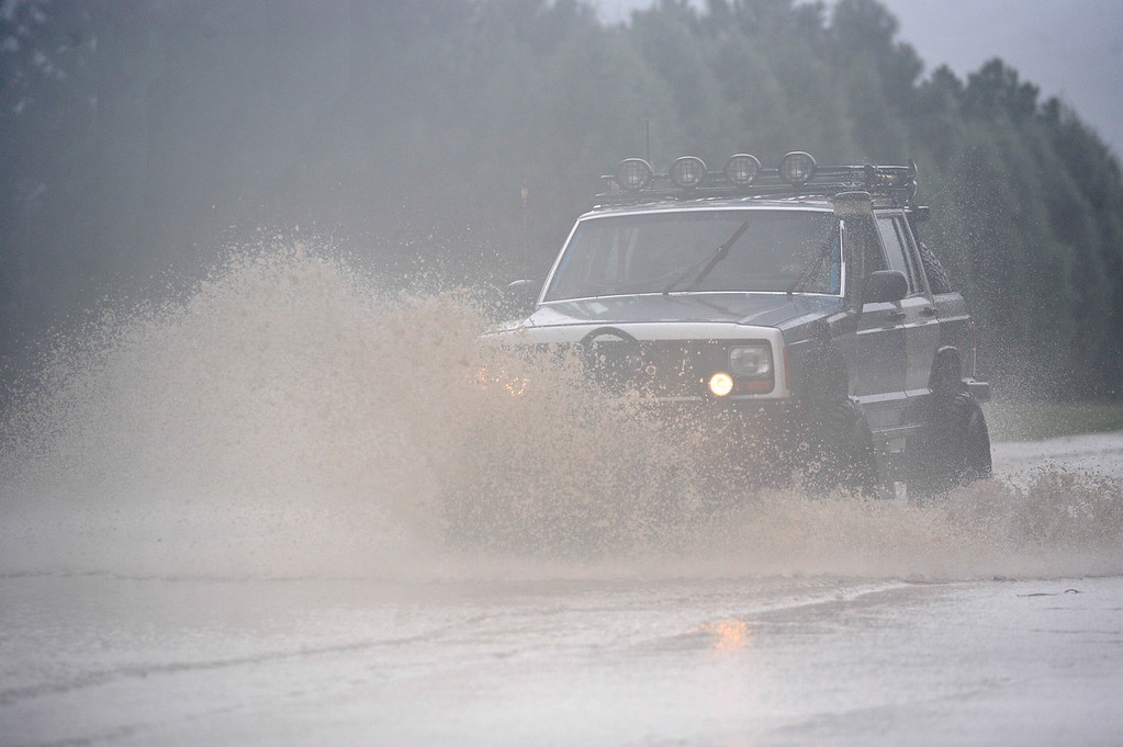 . A SUV drives through high water on Hover Street, Thursday, Sept. 12, 2013, in Longmont. (Matthew Jonas/Times-Call)