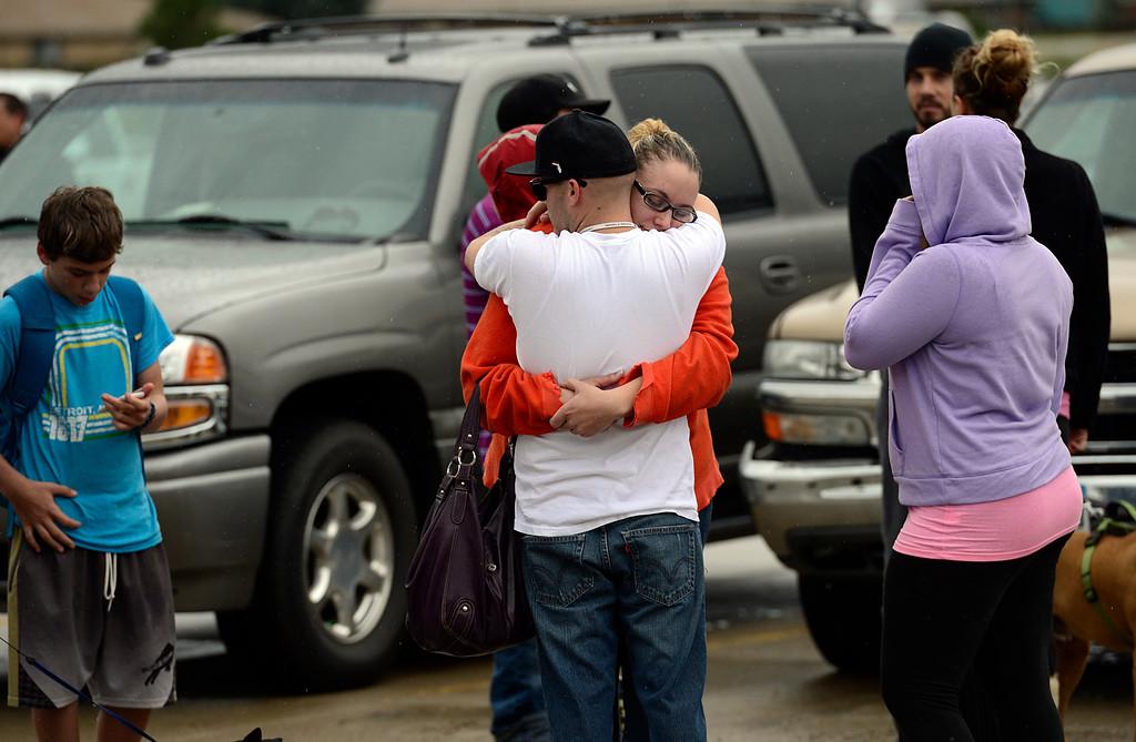 . Lyons evacuee Jessie Neueman gets a hug from Justin Abbott at LifeBridge Church Friday Sept. 13, 2013. (Lewis Geyer/Times-Call)