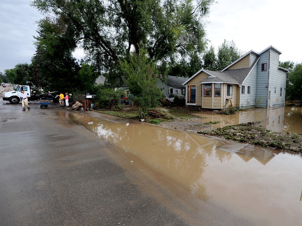 . S. Bowen Street near 1st Ave in Longmont still has about a foot of water in some places on Saturday morning. Cliff Grassmick / September 14, 2013
