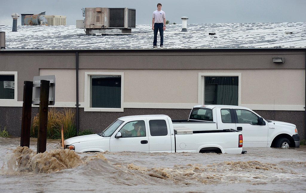 . A man sits trapped in his pickup outside W.P. Manufacturing at Price Road and Boston Avenue 12 p.m. Thursday Sept. 12, 2013. Eventually he was able to move his pickup closer to the building and walk into it. (Lewis Geyer/Times-Call)