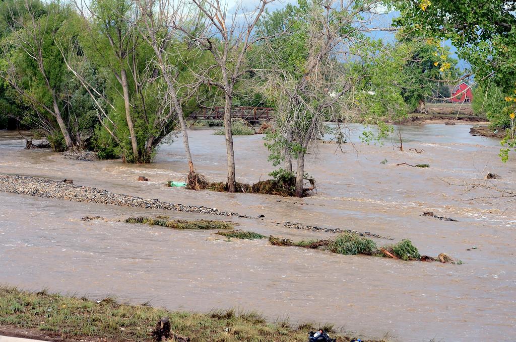 . The flooded St Vrain river seen from the Martin Street bridge on the morning of September 14, 2013. Cliff Grassmick / September 14, 2013