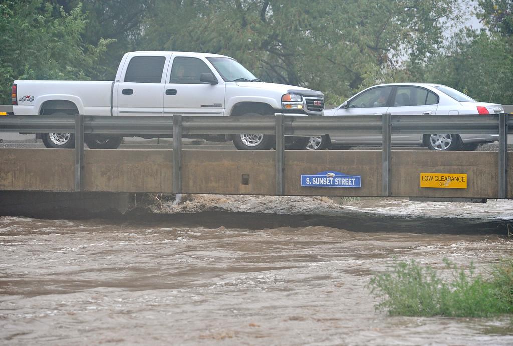 . Vehicles pass over St. Vrain River on South Sunset St., Thursday, Sept. 12, 2013, in Longmont. (Matthew Jonas/Times-Call)