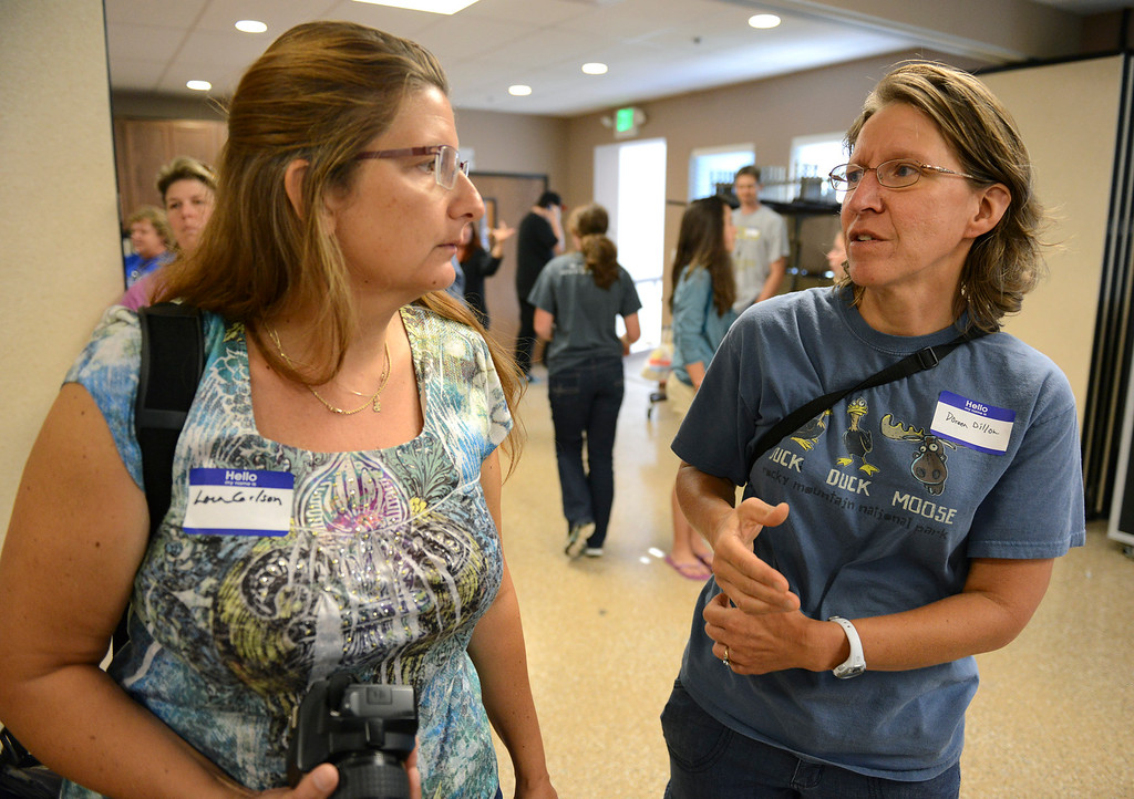 . Lyons evacuees Lora Gilson, left, and Doreen Dillon talk during a gathering of Lyons-area school students and their families at Calvary Church, 2101 Gay St., Monday afternoon, Sept. 16, 2013. (Lewis Geyer/Times-Call)