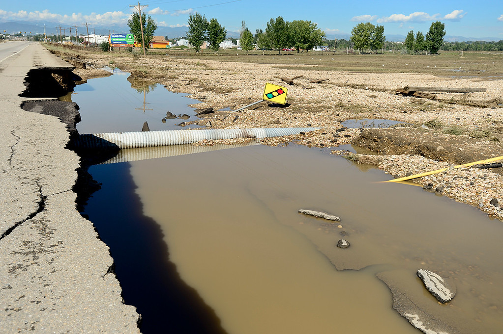 . A crumbling section of Highway 119 is seen east of Longmont, Tuesday, Sept. 17, 2013, in Weld County. (Matthew Jonas/Times-Call)