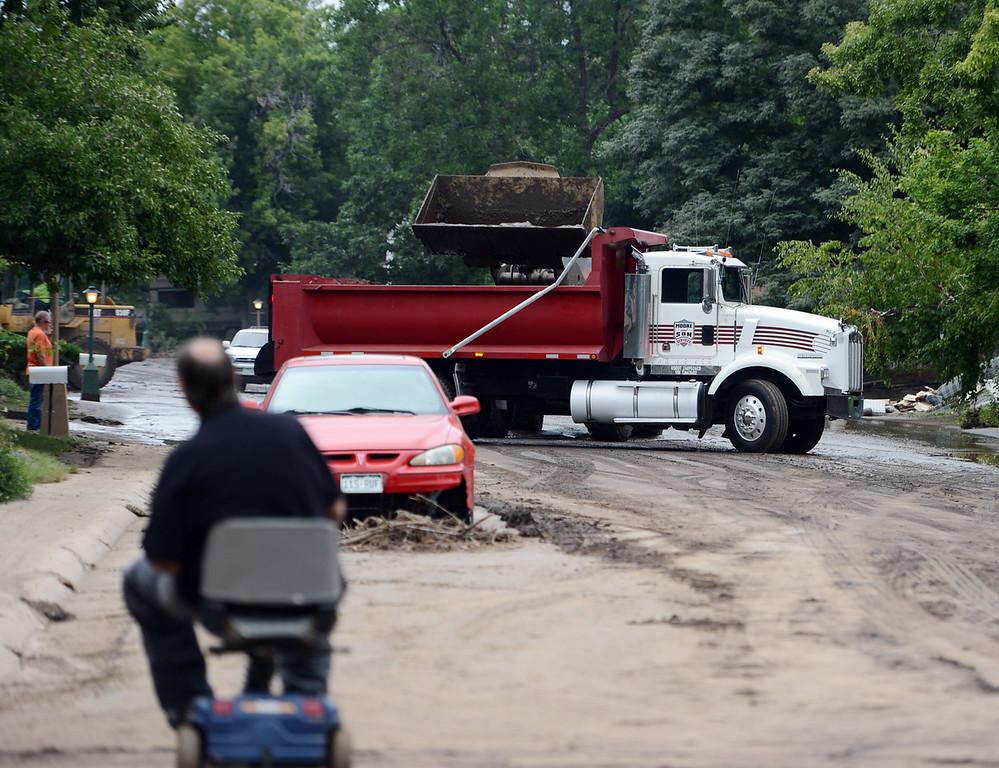 . Longmont city trucks collect the mud on Lefthand Dr. in Longmont, Colorado on September 15, 2013. Cliff Grassmick / September 14, 2013