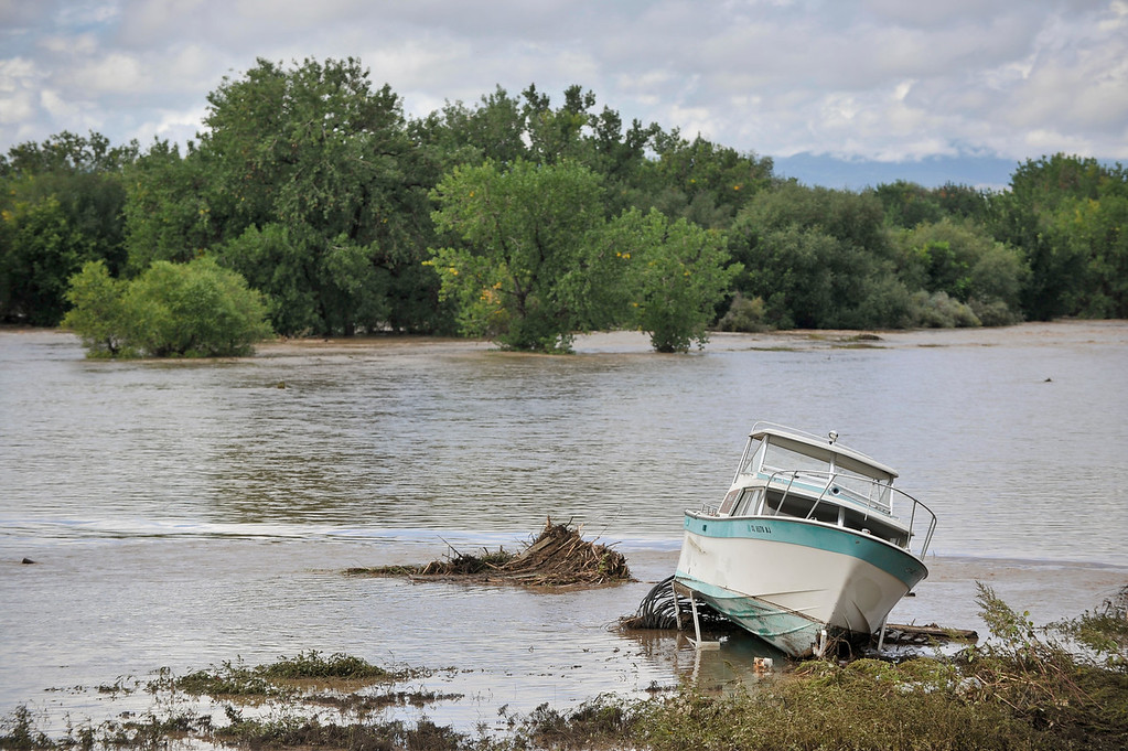 . A boat on a trailer is seen in the flood waters of St. Vrain River off County Line Road, Friday, Sept. 13, 2013, near Longmont. (Matthew Jonas/Times-Call)