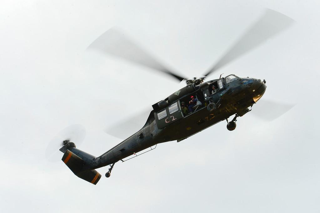 . A Colorado National Guard helicopter flies over Lyons, Monday, Sept. 16, 2013. (Matthew Jonas/Times-Call)