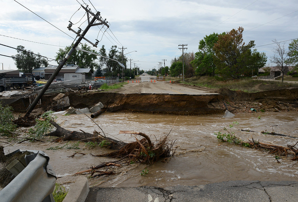 . The washed out bridge on South Sunset Street Saturday morning, Sept. 14, 2013. (Lewis Geyer/Times-Call)