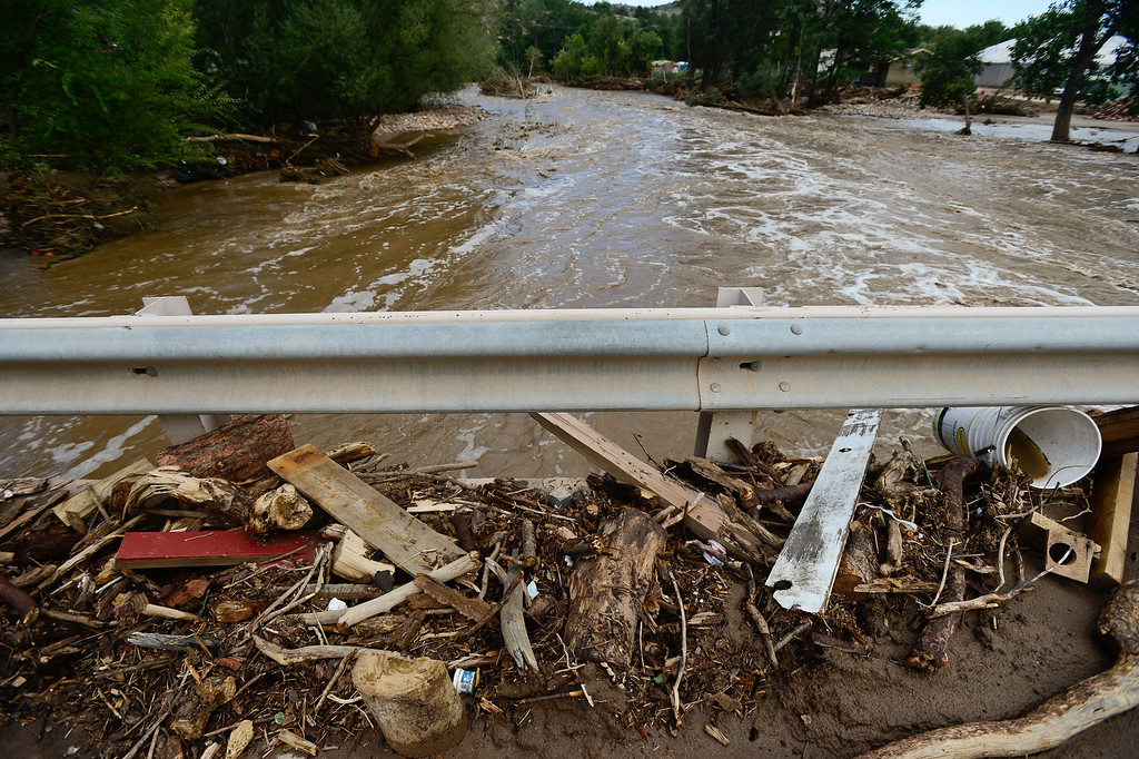 . Piles of debris are seen on the along a guard rail on 2nd Avenue, Monday, Sept. 16, 2013, in Lyons. (Matthew Jonas/Times-Call)