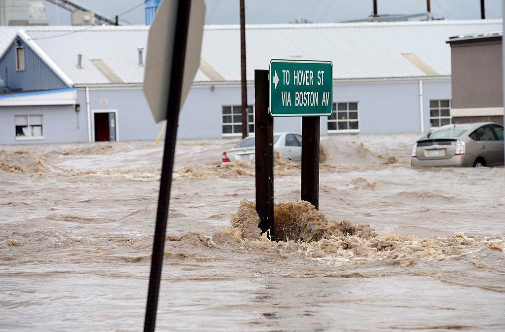 . A flooded Boston Avenue Thursday Sept. 12, 2013. (Lewis Geyer/Times-Call)