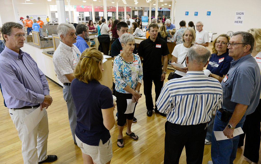 . Volunteers are organized at the Disaster Recover Center, in Twin Peaks Mall, Wednesday morning, Sept. 18, 2013. (Lewis Geyer/Times-Call)