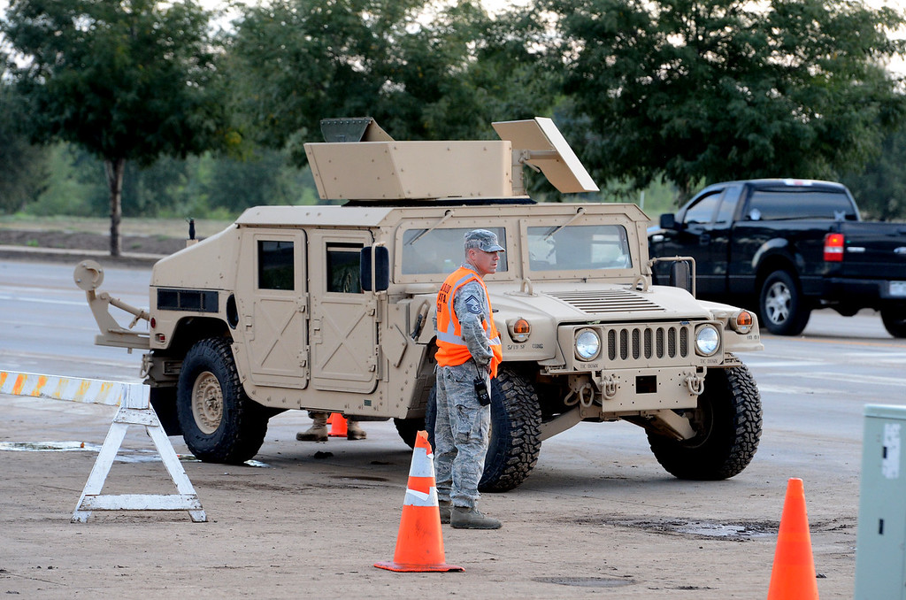 . National Guard troops stationed at  S. Main Street and Missouri at sunrise of Saturday morning. The guards wouldn\'t give names.  A total of 56 Colorado National Guard have been stationed with 28 Humvees at traffic control points throughout Longmont. Cliff Grassmick / September 14, 2013