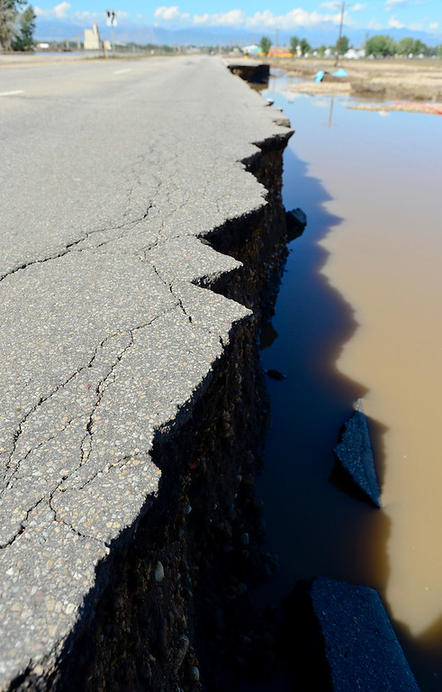 . A crumbling section of Highway 119 is seen east of Longmont, Tuesday, Sept. 17, 2013.  (Matthew Jonas/Times-Call)