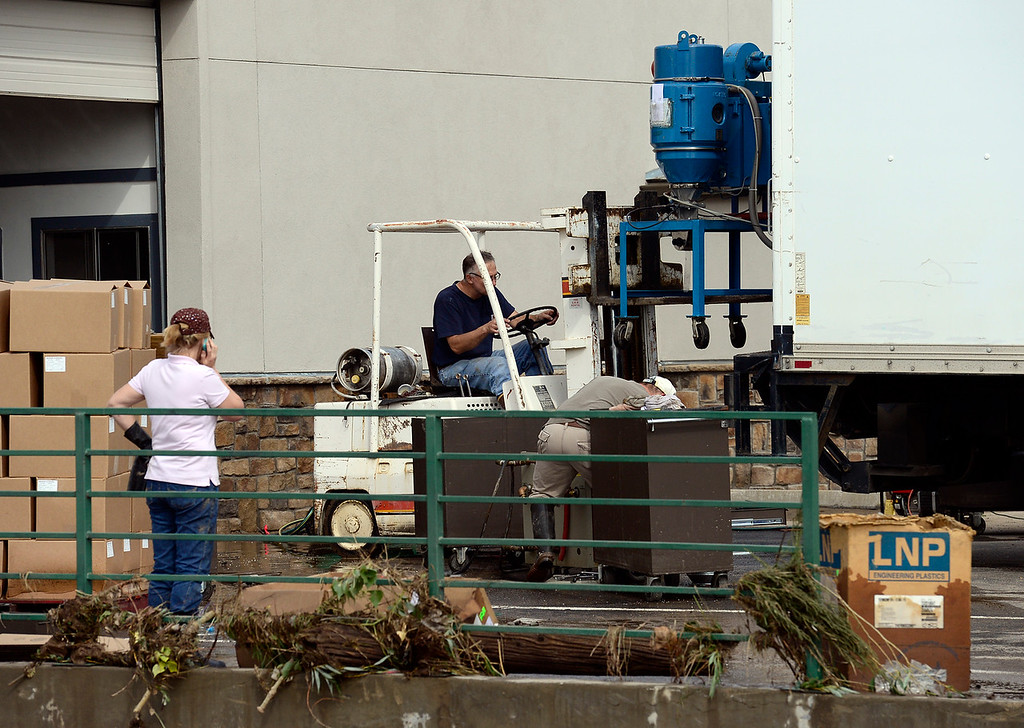 . Equipment is loaded onto a truck on Gay Street Saturday morning, Sept. 14, 2013. (Lewis Geyer/Times-Call)