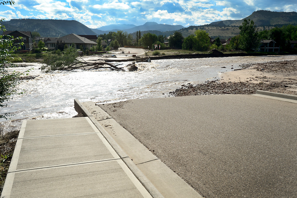 . A large section of roadway missing near the McConnell Drive bridge is seen, Monday, Sept. 16, 2013, in Lyons. (Matthew Jonas/Times-Call)