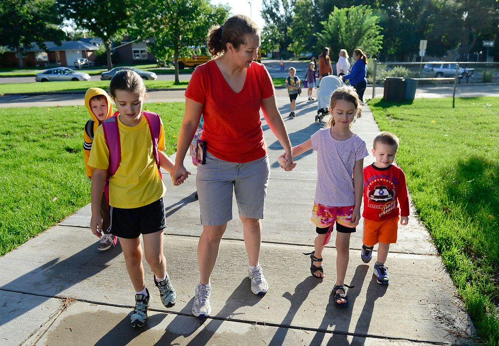 . Sophia Wood walks her fourth-grade daughter Helena, left, to class with her other children Opal, 7, who is home schooled, and Roger, 2, at Burlington Elementary Thursday morning, Sept. 19, 2013. (Lewis Geyer/Times-Call) TO VIEW A VIDEO VISIT WWW.TIMESCALL.COM